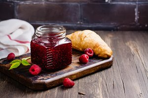 Raspberry jam and fresh raspberry