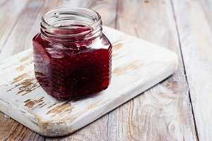 Raspberry jam in glass jar