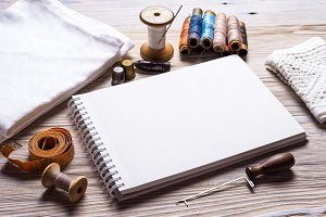 Craft supplies on wooden background