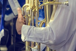 Musician with polished tuba