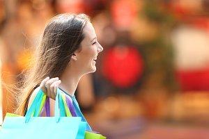 Happy shopper walking