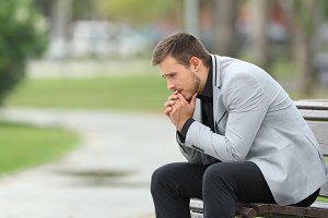 Worried businessman sitting