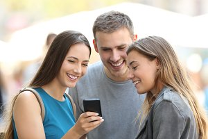 Friends sharing smart phone