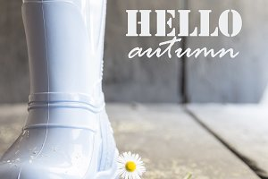 hello autumn, daisy and boots on a old vintage table