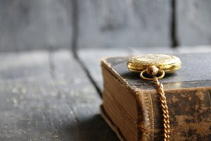 Vintage School background with pocket watch and book