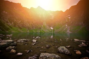 Sunset over lake in mountains.