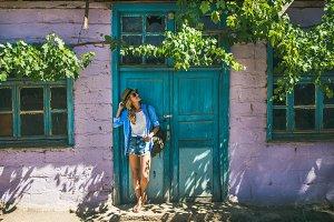 Girl standing near purple wall