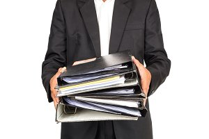 Businessman is holding many document