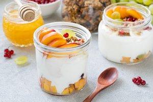 Greek yogurt, granola and fruits breakfast in jar