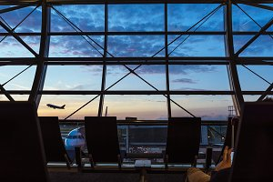 Silhouettes from inside of Airport.