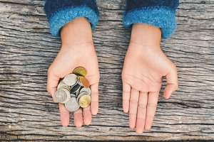 Hands girl holding coin