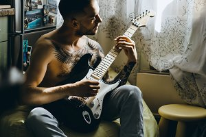 man and guitar