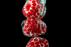 Stack of the raspberries in water