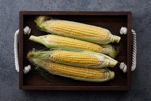 Sweet corns in wooden tray