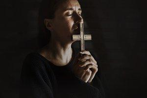 Woman praying with hopeless