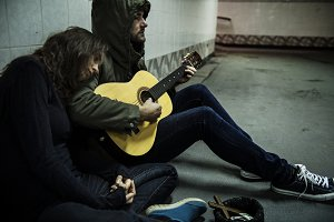 Homeless playing guitar