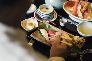 People eating Japanese food