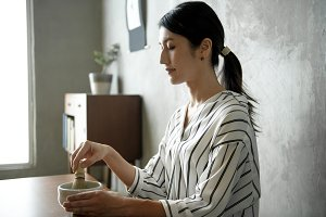 Woman with Japanese tea ceremony