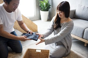 Couple folding the clothes