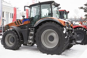 Agricultural tractor at winter snow day