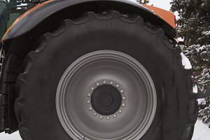 Wheel's tire of a agricultural tractor at winter snow day