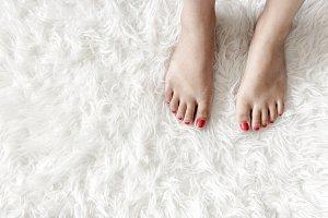 Woman foot on a mat