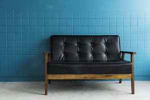 Vintage sofa with blue wall