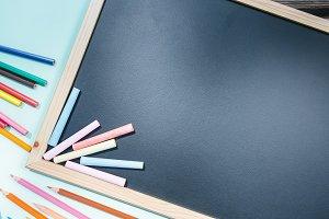 Clear blackboard with chalks