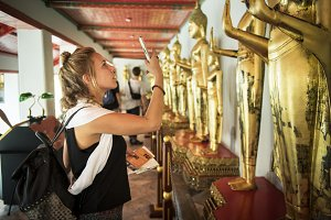 Young woman tourist at temple