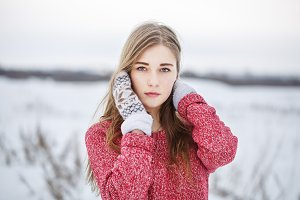 cute serious young girl in winter