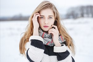 young blond girl in winter