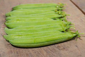 Green pea pods on a table