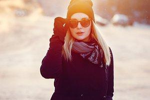 girl in city in winter sunset