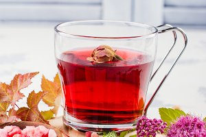 Red herbal tea with herbs and flowers