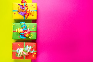 Gift boxes on colorful background