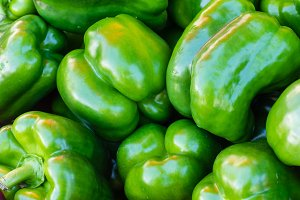 Green bell peppers at the market