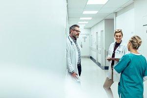 Medical team discussing in corridor