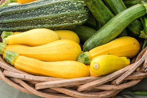 Yellow and green squash in basket