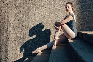 Ballet dancer sitting on stairs