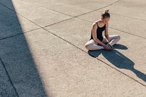 Female ballet dancer warming up