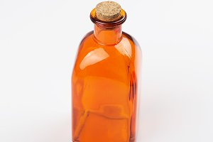 Glass jar of orange color on white background. Isolated. Container.
