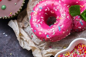 Colorful donuts on a grunge rusty table