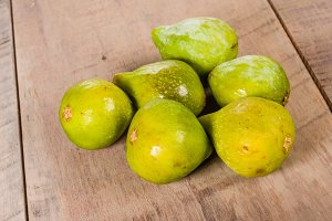 Green figs on wooden table