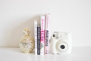 Books, Toy Camera, & Pineapple Jar