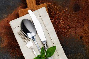 Vintage silverware on dark table