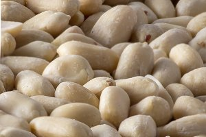 Raw peanuts for the background