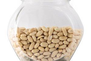 Raw peanuts in big glass tare