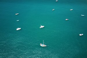 White boats in blue water