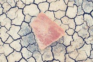 Stone on desert ground