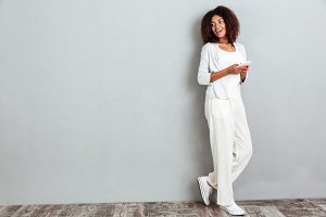 Full length portrait of young casual afro american woman